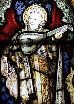 Angel playing lute from stained glass window